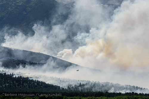 Helicopter hauling water into the Duckett fire.