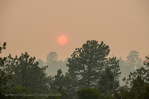 Smoke from West Fork complex wildfire, about 90 air miles southwest of us, obscures evening sun.
