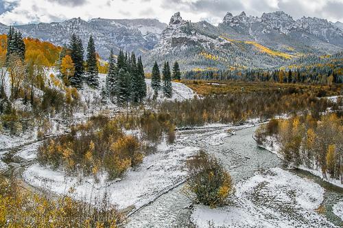 Fresh new snow decorates an autumn landscape along the Cimarron River in the Uncompahgre Range; wilderness; Uncompahgre National